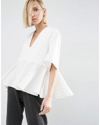 ASOS | Stripe Peplum Top With V-neck | Lyst