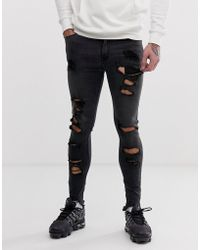 ASOS Spray On Jeans In Power Stretch With Raw Hem And Heavy Rips In Washed Black
