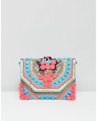 Park Lane - Folder Pom Pom Clutch Bag With Detachable Strap - Lyst