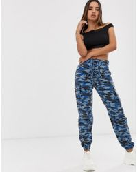 Missguided - Lace Up Camo joggers - Lyst