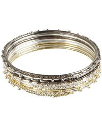 Chamak by Priya Kakkar - Set Of 8- Gold, Silver And Gunmetal Dot Spiked Metal Thin Bangles - Lyst