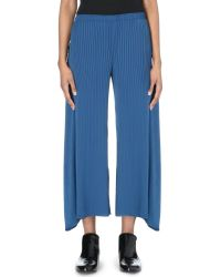Issey Miyake Wide Leg Pleated Trousers - Lyst