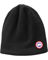 Lyst - Canada Goose Logo Knit Beanie in Black for Men 4ed29fd25ade