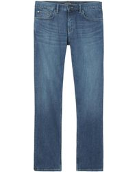 Banana Republic - Straight Rapid Movement Denim Light Wash Jean - Lyst