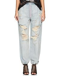Alexander Wang - Distressed Denim Jogger Trousers - Lyst
