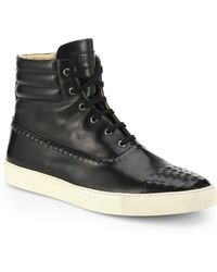Alexander McQueen Studded Leather High-Top Sneakers - Lyst