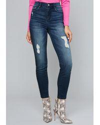 Bebe - Studded Pocket Skinny Jeans - Lyst