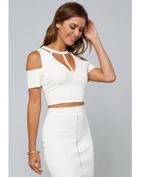 e9ce075a92579 Lyst - Bebe Textured Off Shoulder Top in White