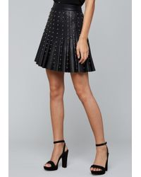 Bebe - Studded Faux Leather Skirt - Lyst