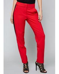 Bebe - Side Stripe Step Hem Trousers - Lyst
