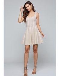 7634e3a611f6 Lyst - Bebe Textured Midi Dress in White