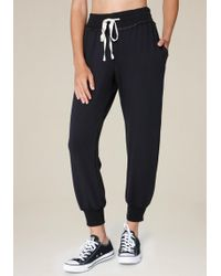 Bebe - Luxe Skinny Jogger Trousers - Lyst