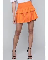 Bebe - Smocked Linen Cupcake Skirt - Lyst