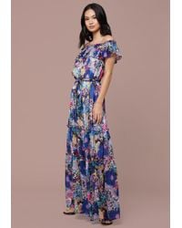 37883ee5d7d Lyst - Bebe Print Deep V Maxi Dress in Red
