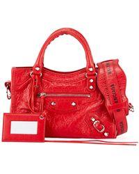 2dcb79436763 Lyst - Balenciaga Leather Mini Pompon Bucket Bag in White