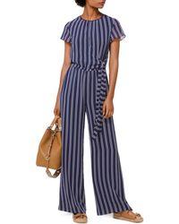 25d00884b85 Lyst - Michael Kors Michael Plus Size Studded Belted Jumpsuit in Blue