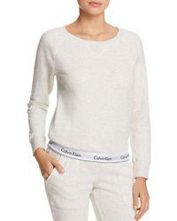 a514ba034096e Lyst - Calvin Klein For Uo Modern Sweatshirt in White