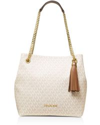 57270a1d8f5cd6 Lyst - MICHAEL Michael Kors Jet Set Large Snap Pocket Tote in Natural
