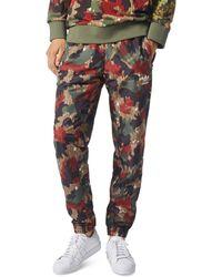 bebb4011dd adidas Originals - X Pharrell Williams Hu Hiking Camouflage Windpants - Lyst