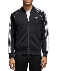 31015d79cf46 Lyst - adidas Originals Allover Print Superstar Track Jacket in ...