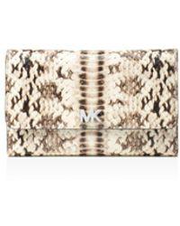 470bd0f27c1c MICHAEL Michael Kors - Medium Embossed Leather Carryall Wallet - Lyst