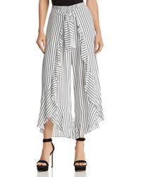 Aqua - Ruffled Striped Tie-front Trousers - Lyst