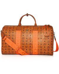 f8224254147 MCM Xl Traveler Visetos Duffel Bag in Gray for Men - Lyst