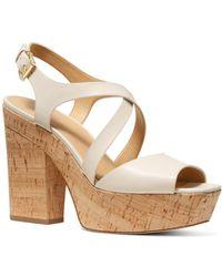 4ecdd3ebb7f9fa MICHAEL Michael Kors - Women s Abbott Leather Platform Wedge Sandals - Lyst