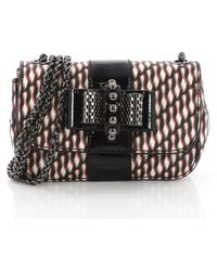ecb95b838da Lyst - Christian Louboutin Sweety Charity Mini Spiked Leather ...