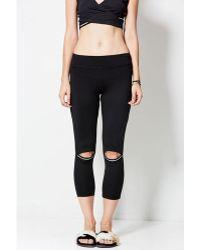 Nesh NYC - Activate Crop Peek A Boo Legging - Lyst