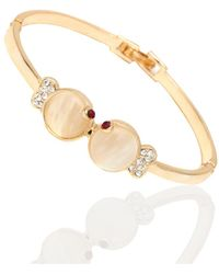 Peermont - Gold And Ruby Crystal Bow Bangle - Lyst