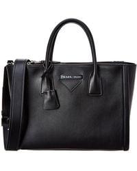 908ee860b9ea Lyst - Prada Pebbled Leather Saddle Bag in Black