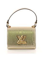 Louis Vuitton - Twist Handbag Gravity Gold Calfskin Pm - Lyst