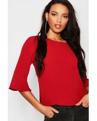 254dced40b9dc1 Boohoo Shirred Ruffle Hem Bardot Top in Red - Lyst