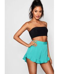 Boohoo - Solid Colour Ruffle Hem Shorts - Lyst