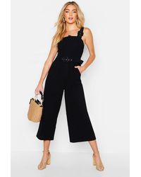 Boohoo - Belted Buckle Strap Jumpsuit - Lyst