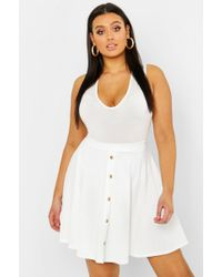 Lyst - Boohoo Plus Button Front Ribbed Skater Mini Skirt in Red e90fce610