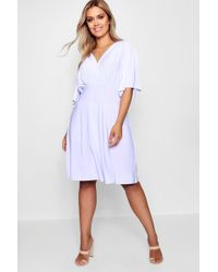 Boohoo - Plus Slinky Wrap Over Skater Dress - Lyst
