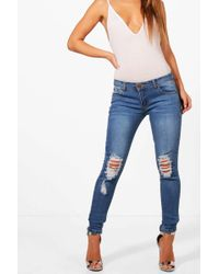 eb6e2c311f Lyst - Boohoo Eve Low Rise Rip Patch Distressed Skinny Jeans in Blue
