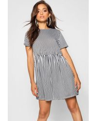 8570c641a542 Boohoo Olivia Tiered Ruffle Smock Dress in Black - Lyst