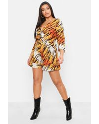 Boohoo - Plus Tiger Print Ruffle Tie Front Playsuit - Lyst