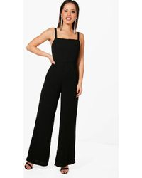 Boohoo - Petite Square Neck Wide Leg Jumpsuit - Lyst