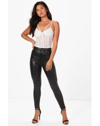 Lyst - Boohoo Rhea Lace Up Stretch Leather Look Skinny Trousers in Black 77c58283b