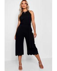 278e83400ff Boohoo Plus Crepe Ruffle Waist Wide Leg Jumpsuit in Black - Lyst
