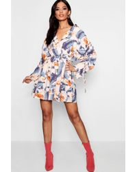 Boohoo - Daisy Ruched Sleeve Wrap Front Shirt Dress - Lyst