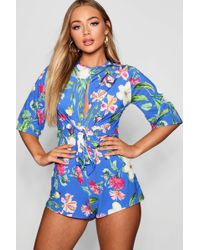 3dcea72a91d Boohoo Floral Tie Front Playsuit in Blue - Lyst