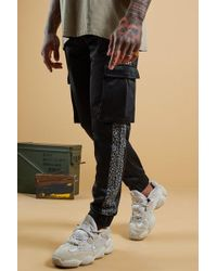 1ef2a19049a0 BoohooMAN - Leopard Side Panel Tricot Cargo Jogger - Lyst