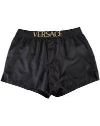 Versace - Black/gold Text Swim Shorts - Lyst