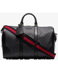 Gucci - Black Logo Print Leather Trim Canvas Duffle Bag - Lyst