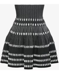 Alaïa - High Waisted Knit Mini Skirt With Contrasting Pleats - Lyst